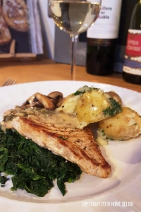 Griddled pork steak and herby potatoes